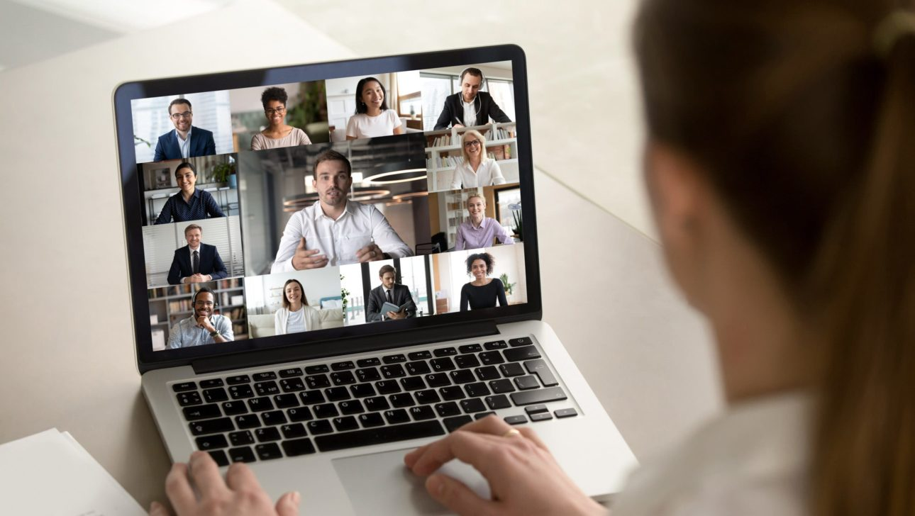 woman on a video call look at laptop