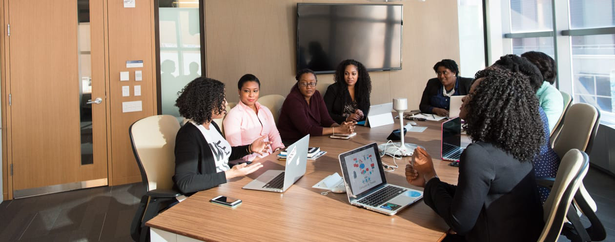 Women meeting around office table